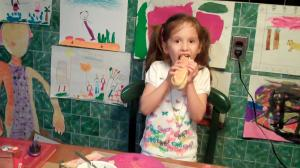 P enjoys a hot dog